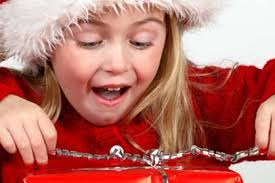 girl opens gift smiles