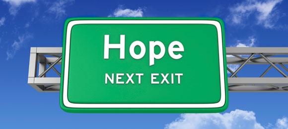road sign hope sky